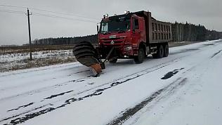 Снегоуборочная страда на дорогах области